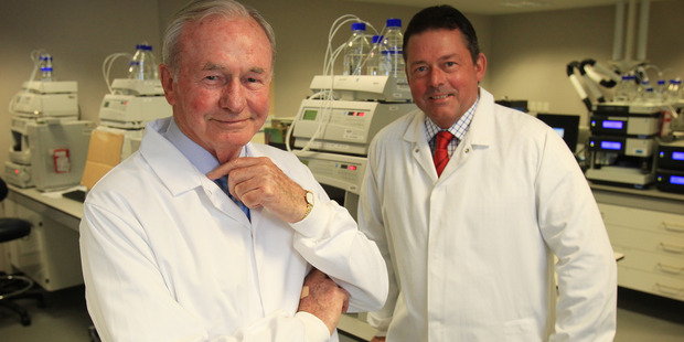 Sir Graeme Douglas with his son Jeff in one of the labs at Douglas Pharmaceuticals in Henderson, Auckland. File photo / Greg Bowker