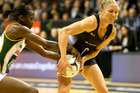 Silver Ferns centre Laura Langman battles with South Africa's Precious Mthembu. Photo / Alan Gibson