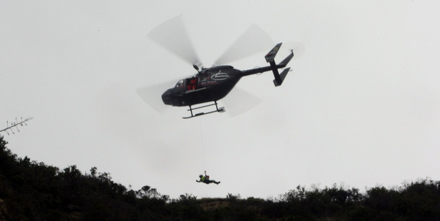 A teen was winched to safety by the Nelson Marlborough Rescue Helicopter yesterday. Pictured is a rescue in Napier earlier this year. Photo / Paul Taylor