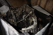 The remains of a Samsung washing machine, which caught fire and caused significant damage to a laundry and bathroom area of a house.