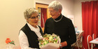 Lion Barbara Fergusson (right) presents Jo Guy with flowers at Dannevirke Host Lions Guest Night.