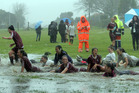 The Kaitaia College 1st and 2nd XI girls teams cool off with a refreshing slide into a pond on the college bottom fields after playing each other in the NSSSA Division 1 final last Wednesday. Kaitaia A (maroon strip) won 4-1.