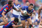 Michael Lichaa of the Bulldogs is tackled during the round 22 NRL match between the Newcastle Knights and the Canterbury Bulldogs. Photo / Getty