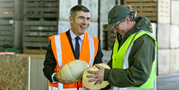 Nathan Guy shares a joke with Warren Lowes at Bostock exporters in Hastings. Photo / Warren Buckland