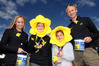 Imogen Lovell (second from left), 12, and Tatyana Crawley, 13, wear a splash of yellow while helping Hamish Bond and Anita McLaren raise money for the Hawke's Bay Cancer Society. Photo / Paul Taylor