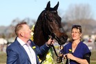 Trainer Allan Sharrock and strapper Emma Davies with two-time champion Kawi. Photo / Paul Taylor