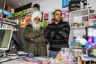 Sukhjinder Pal Singh (right) and his 61 year old father fought off two armed robbers.