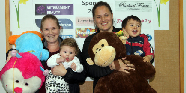 Daffodil Day baby photo competition winner Malcolm Windleborn and his mum Renee (right), with Section 1 winner Easton Booth and mum Tara.
