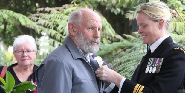 Trevor Bedggood receives his Far North District Council Civic Award from Lieutenant Commander Angela Barker of the Royal New Zealand Navy.