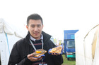 Malaysia's Wei Sheng Phee tries whitebait fritters at Fieldays.