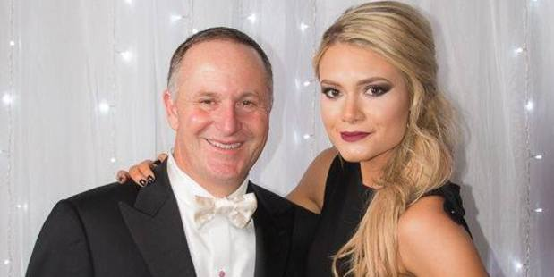 Sarah Higgins, local board member and Young Nat, pictured here Prime Minister John Key, died suddenly at the weekend. Photo / Supplied