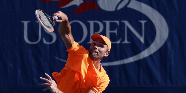 Ivo Karlovic, of Croatia, serves to Yen-Hsun Lu, of Taipei, during the first round of the U.S. Open tennis tournament. Photo / AP