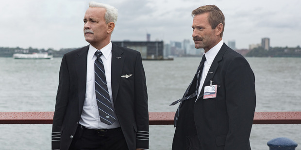 Tom Hanks as Sully and Aaron Eckhart as Jeff Skiles in the film Sully.
