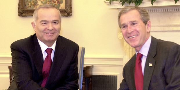 March 12, 2002, U.S, President George W. Bush, right, meets with the President of Uzbekistan, Islam Karimov, left, in the Oval Office at the White House. Photo / AP