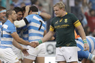 South Africa's captain Adriaan Strauss, right, will retire from international rugby at the end of the season. Photo / AP