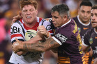 Dylan Napa of the Roosters is tackled by Corey Parker of the Broncos. Photo / Getty