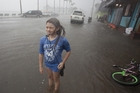 Hannah Coles, 9, plays in the rain in Gulfport as Hurricane Hermine headed towards Miami yesterday. Picture / AP