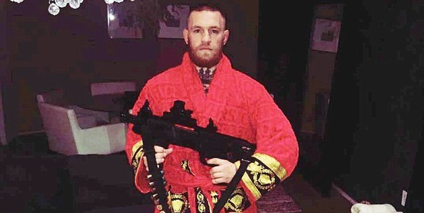 Conor McGregor poses with a shotgun. Photo / Instagram