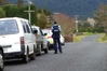A policeman looks down the road in rural Katikati, where an armed cordon has been set up by police this afternoon. Photo/Andrew Warner