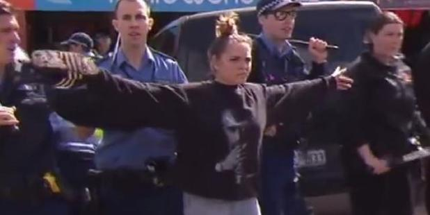 Hayley Garlett was among family members trying to keep the peace. Photo / Nine News