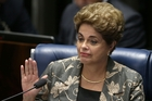 Suspended Brazilian President Dilma Rousseff waves goodbye after her impeachment trial at the Federal Senate in Brasilia, Brazil. Photo / AP
