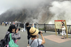 Visitors to Owakudani Park in Hakone, Japan, stop for photos against the background of volcanic plumes. Photo / Japan News-Yomiuri