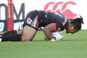 Solomone Kata scores during the NRL match between the Warriors and the West Tigers. Photo / Photosport