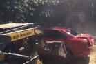 Dad destroys daughter's car. Photo / Kaylor Card, Facebook