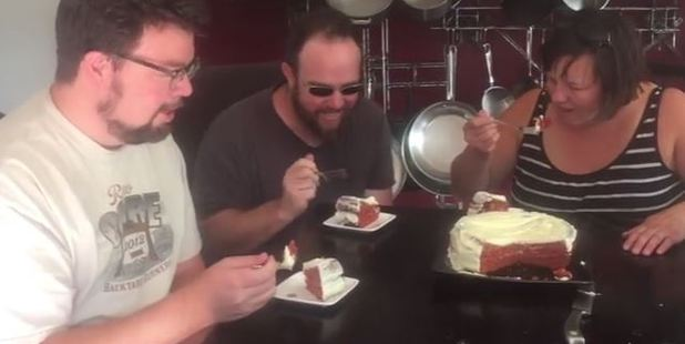 Gregory Nuttle's friends try the cake after the social media frenzy. Photo / Youtube