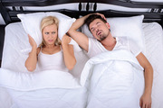 Researchers say air pollution from traffic could be a key cause of snoring. Photo / 123rf