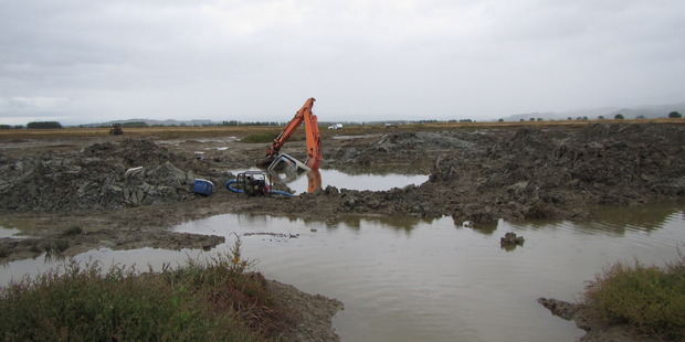 A duck shooter found himself in trouble over digging an illegal duck pond in protected wetland when his stuck digger alerted the Waikato Regional Council. Photo / Supplied.