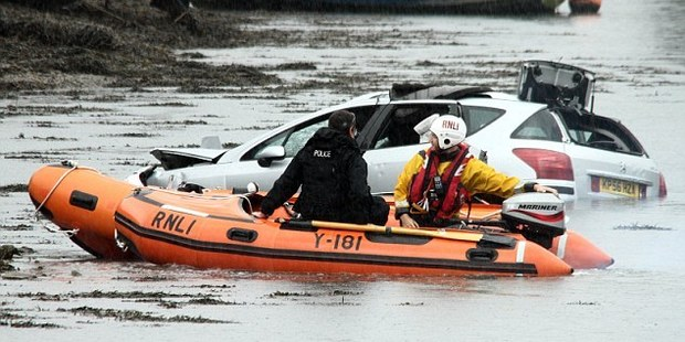 Police and emergency service attend the scene at Hooe Lake, Plymouth, Devon, in the UK.
