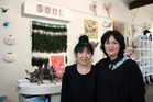 Left to right: Soul Gallery manager Francis Moy and owner Lisa Voigt.