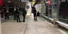 Watch: Watch: Masked 'Zorro' detained during LAX stampede