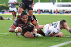 Solomone Kata scores a try during the Warriors' loss against the Tigers last weekend. Photo / photosport.nz