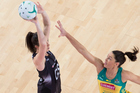 Bailey Mes shoots as Jane Watson attempts to block during the Netball Quad Series match between Australia and New Zealand. Photo / Photosport