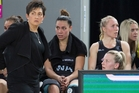 Silver Ferns players and coaching staff try to take in their 60-55 loss to the Diamonds after the netball Quad Series final yesterday. Photo / Photosport