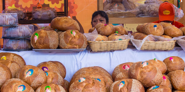 A women selling traditional 'Bread of the Dead' at the Oaxaca Market. Photo / 123RF