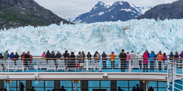 Tourists observe the Margerie Glacier up close from a cruise ship. Photo / 123RF