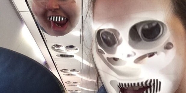 A passenger has used Snapchat to face swap with a plane cabin interior during a flight. Photo / Reddit