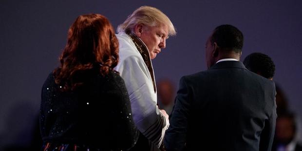Donald Trump wears a prayer shawl in a Detroit church. Photo  / AP