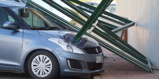 Loading Windows damaged vehicles parked at the Novotel today.  Photo/Ben Fraser