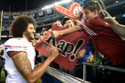 San Francisco 49ers quarterback Colin Kaepernick greets fans after the 49ers' 31-21 win over the San Diego Chargers during an NFL preseason game last week in San Diego. Photo / AP