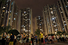 People queue at a polling station at night to vote for the legislative council election at a housing estate in Hong Kong. Photo / AP