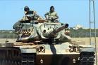 A Turkish tank headed to the Syrian border, in Karkamis, Turkey. Photo / AP