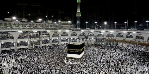 Muslim pilgrims circle the Kaaba, Islam's holiest shrine, at the Grand Mosque in the Muslim holy city of Mecca. Photo / AP