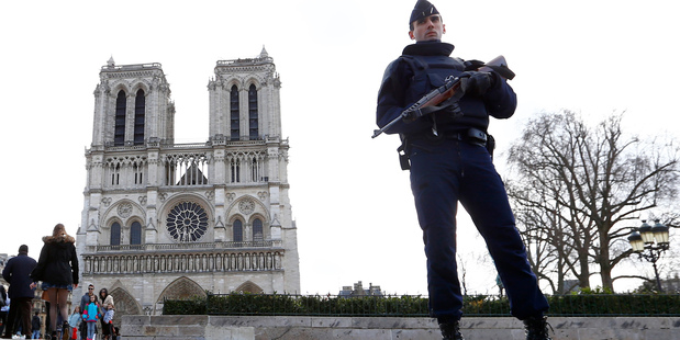 A French police officer stands guard at Notre Dame Cathedral in Paris earlier in the year. Photo / AP