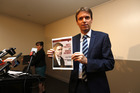 Colin Craig with the pamphlet that allegedly defamed Taxpayers' Union director Jordan Williams. Photograph/Dean Purcell.