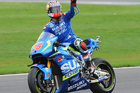 Spain's Maverick Vinales of Suzuki celebrates after winning the Moto GP race at Silverstone. Photo / AP