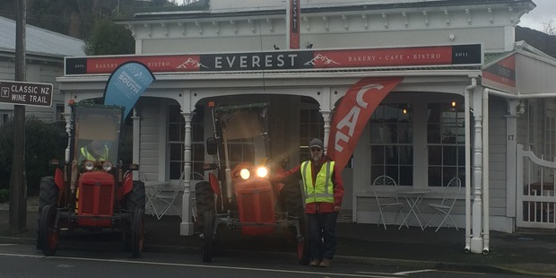The tractors parked up in front of a cafe in Featherston names Everest. Photo / Supplied
